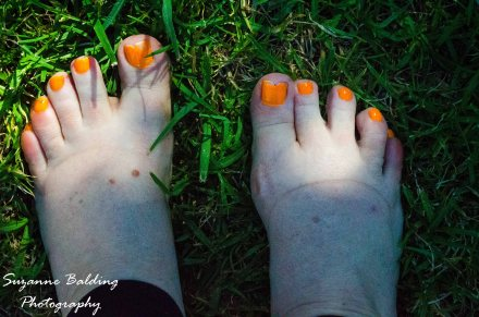 Cool green grass under the toes feels magical on a hot afternoon.