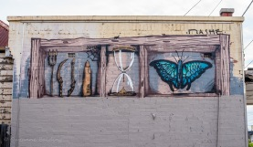 This mural was enhanced by the dilapidation of the adjoining building.